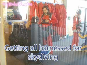 Getting all harnessed for skydiving