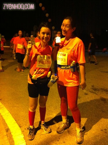 Ika and I with our medals. Note that I'm wearing pink pants to challenge Ika's pink calf sleeves, hehehe.