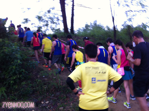 Going upslope at the off-road section. I could hear a lot of grumbling as the runners trekked the small slope up.