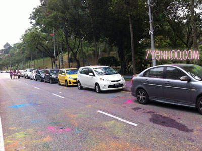 The cars at the roadside covered in coloured powder