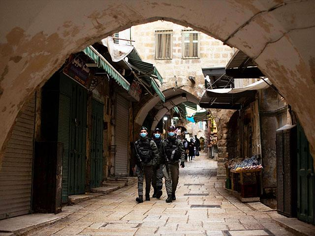 Israeli police patrol the Muslim Quarter of the Old City of Jerusalem, Friday, Jan. 15, 2021 during the country's third lockdown. (AP Photo/Maya Alleruzzo)