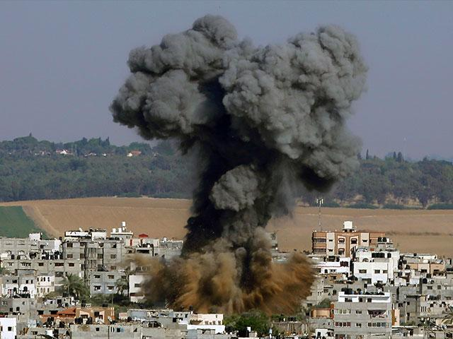 In this May 11, 2021, file photo, smoke rises after an Israeli airstrike in Gaza City.