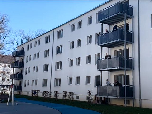 Screen capture of a US military housing in Germany where a worship service was held from a balcony.