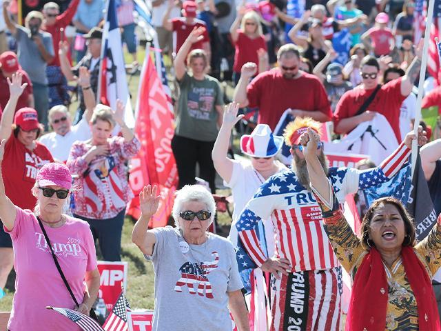 Supports of President Donald Trump pray during a rally in Conroe, Texas, Nov. 7, 2020. (Jason Fochtman/Houston Chronicle via AP)