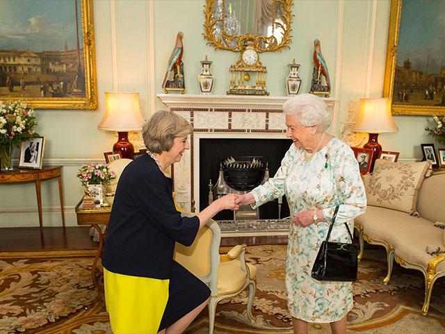 Queen Elizabeth II welcomes Theresa May, AP photo