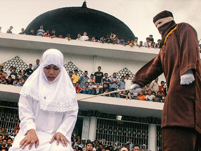 Shariah law officer canes a woman