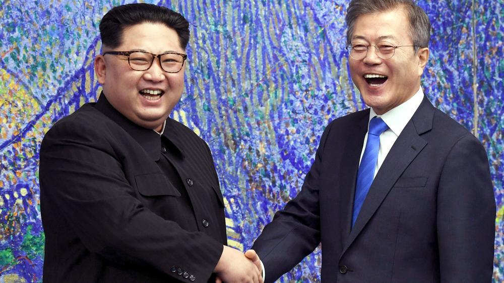 Image result for images of korean leaders shaking hands