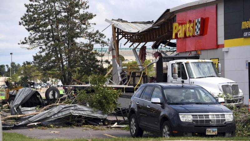 The aftermath of tornado damage to Advance Auto Parts on 41st Ave, is seen, Wednesday, Sept. 11, 2019, in Sioux Falls, S.D. (Erin Bormett/The Argus Leader via AP)