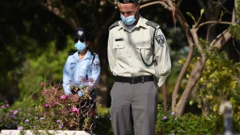 Israeli service members leave flags, flowers, and candles on the graves of fallen soldiers. April 27.