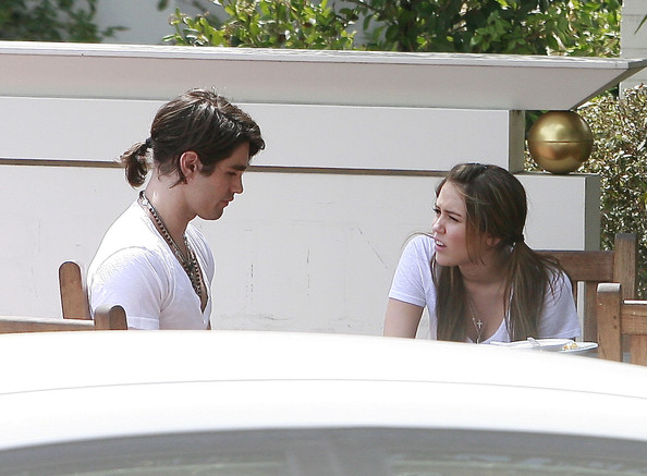 Miley Cyrus and Justin Gaston having a fight about their relationship after lunch at a studio.