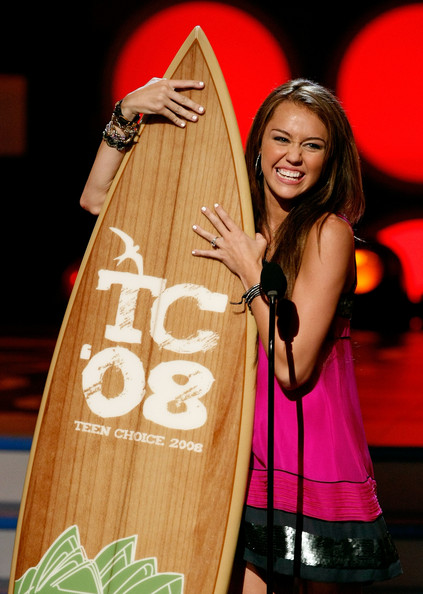 Singer/actress Miley Cyrus accepts the Choice TV Actress award onstage during the 2008 Teen Choice Awards at Gibson Amphitheater on August 3, 2008 in Los Angeles, California.
