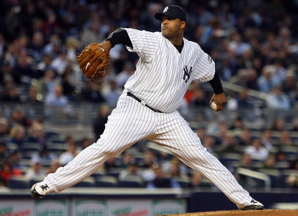 CC Sabathia #52 of the New York Yankees pitches against the Baltimore Orioles at Yankee Stadium May 19, 2009 in the Bronx borough of New York City.  (Photo by Jim McIsaac/Getty Images) *** Local Caption *** CC Sabathia