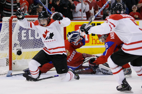 Jordan Eberle #14 of Team Canada reacts after having scored the tying goal on Vadim Zhelobnyuk #1 of Team Russia forcing overtime during the semifinals at the IIHF World Junior Championships at the Ottawa Civic Centre on January 03, 2009 in Ottawa, Ontario, Canada. Team Canada defeated Team Russia 6-5 in a shootout.  (Photo by Richard Wolowicz/Getty Images) *** Local Caption *** Jordan Eberle;Vadim Zhelobnyuk;PK Subban