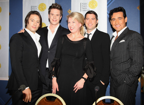 Elina Vahala poses for a photograph with Il Divo at a press conference for the Nobel Peace Prize Concert 2008 at the Radisson SAS Plaza hotel on December 11, 2008 in Oslo, Norway. The Norwegian Nobel Committee yesterday awarded the Nobel Peace Prize for 2008 to Martti Ahtisaari for his important efforts to resolve international conflicts. Actors Michael Caine and Scarlett Johansson are due to host the gala event tonight which features performances from Diana Ross, operatic quartet Il Divo and Swedish singer-songwriter Robyn  (Photo by Chris Jackson/Getty Images) *** Local Caption *** Elina Vahala;Il Divo