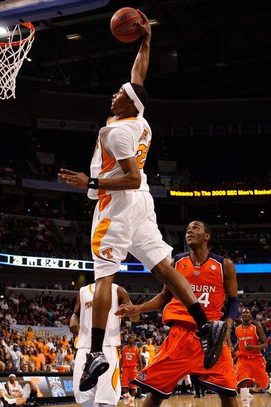 Scotty Hopson #32 of the Tennessee Volunteers dunks the ball over Tay Waller #24 of the Auburn Tigers during the Semifinal round of the SEC Men's Basketball Tournament on March 14, 2009 at The St. Pete Times Forum in Tampa, Florida.  (Photo by Chris Graythen/Getty Images) *** Local Caption *** Scotty Hopson;Tay Waller