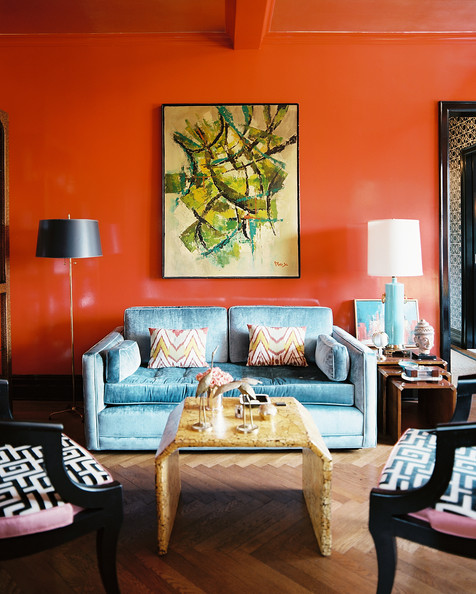 Sofa - Red lacquered walls and a blue couch on herringbone hardwood floors