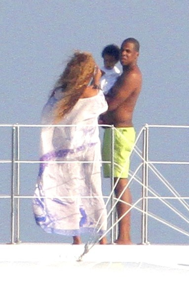 Jay-Z can't put his daughter Blue Ivy (b. January 7, 2012) down as he and Beyonce vacation aboard their yacht in the South of France. Beyonce snaps pictures of Blue in Jay-Z's arms  before the new family lays down to relax together on a sun lounger.