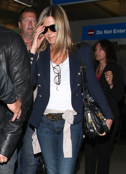 "Jennifer Aniston Actress Jennifer Aniston shows off her new, diamond engagement ring as she arrives on a flight with her fiance Justin Theroux at LAX airport in Los Angeles, California on June 25, 2012. The couple recently spent a romantic vacation in Paris, the ""City of Love,"" and that would be the ideal place for Justin to have popped the question..."