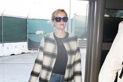 'Wild' actress Reese Witherspoon departing on a flight at LAX airport in Los Angeles, California on February 6, 2014. Reese will soon be featured on the cover of the 21st annual Vanity Fair Hollywood Issue, with fellow stars Amy Adams and Channing Tatum.