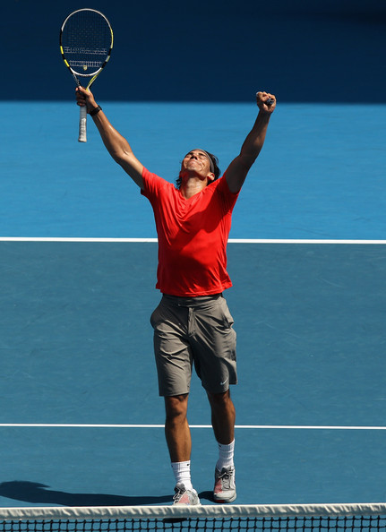 "Rafael Nadal of Spaincelebrates a point during the ""Rally For Relief"" charity exhibition match ahead of the 2011 Australian Open at Melbourne Park on January 16, 2011 in Melbourne, Australia."