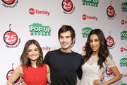 "Actor Lucy Hale, Tyler Blackburn and Shay Mitchell attend ABC's ""25 Days Of Christmas"" Celebration at Cucina at Rockerfellar Center on December 7, 2014 in New York City."