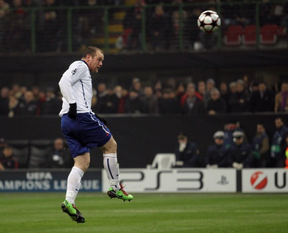 Wayne Rooney of Manchester United heads in his team's third goal during the UEFA Champions League round of 16 first leg match between AC Milan and Manchester United at Stadio Giuseppe Meazza on February 16, 2010 in Milan, Italy.