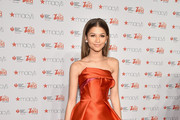 Zendaya attends the Go Red For Women Red Dress Collection 2015 presented by Macy's fashion show during Mercedes-Benz Fashion Week Fall 2015 at Lincoln Center on February 12, 2015 in New York City.