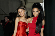 Zendaya Coleman (L) and Ciara pose backstage at the Go Red For Women Red Dress Collection 2015 presented by Macy's fashion show during Mercedes-Benz Fashion Week Fall 2015 at The Theatre at Lincoln Center on February 12, 2015 in New York City.