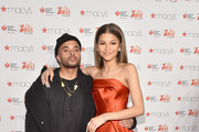 Zendaya Coleman (R) attends the Go Red For Women Red Dress Collection 2015 presented by Macy'sfashion show during Mercedes-Benz Fashion Week Fall 2015 at Lincoln Center on February 12, 2015 in New York City.