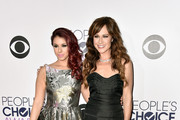 Actresses Jillian Rose Reed (L) and  Nikki Deloach attend The 41st Annual People's Choice Awards at Nokia Theatre LA Live on January 7, 2015 in Los Angeles, California.