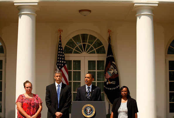 Barack Obama U.S. President Barack Obama (C) stands with laid-off teachers Shannon Lewis (L) and Rachel Martin (R) and Education Secretary Arne Duncan while making a statement encouraging the House of Representatives to pass a $26 billion spending bill to avoid layoffs of teachers, police officers, firefighters, nurses and some private sector jobs in the Rose Garden at the White House August 10, 2010 in Washington, DC. The White House said that Lewis and Martin would be among the first on the list of laid-off teachers in their districts to be re-hired if the House passes the Education Jobs and Medicaid Assistance Act. The House has been called back from its summer recess for one day by Speaker Nancy Pelosi (D-CA) to pass the legislation, which the Senate passed before recessing last week.