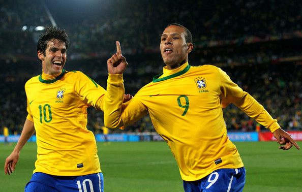 Luis Fabiano of Brazil celebrates scoring his team's second goal with team mate Kaka (L) during the 2010 FIFA World Cup South Africa Round of Sixteen match between Brazil and Chile at Ellis Park Stadium on June 28, 2010 in Johannesburg, South Africa.