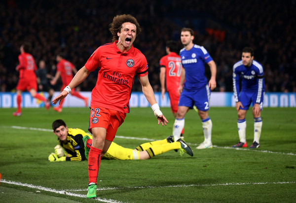 David Luiz of PSG celebrates after teammate Thiago Silva of PSG scores a goal to level the scores at 2-2 during the UEFA Champions League Round of 16, second leg match between Chelsea and Paris Saint-Germain at Stamford Bridge on March 11, 2015 in London, England.