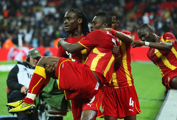 Derek Boateng Asamoah Gyan of Ghana celebrates with Derek Bopateng after he scores the equalising goal during the international friendly match between England and Ghana at Wembley Stadium on March 29, 2011 in London, England.