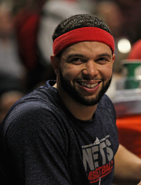 Deron Williams Deron Williams #8 of the New Jersey Nets smiles on the bench after scoring a game-high 29 points against the Chicago Bulls at the United Center on February 18, 2012 in Chicago, Illinois. The Nets defeated the Bulls 97-85. NOTE TO USER: User expressly acknowledges and agrees that, by downloading and or using this photograph, User is consenting to the terms and conditions of the Getty Images License Agreement.
