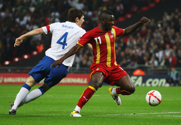Sulley Muntari of Ghana (R) is challenged by Gareth Barry of England during the international friendly match between England and Ghana at Wembley Stadium on March 29, 2011 in London, England.