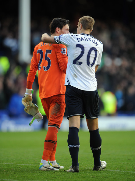 Hugo Lloris of Tottenham Hotspur chats with team-mate Michael Dawson following the Barclays Premier League match between Everton and Tottenham Hotspur at Goodison Park on November 03, 2013 in Liverpool, England.
