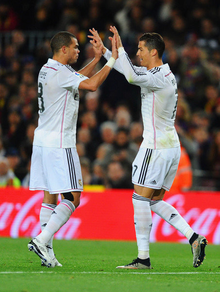 Cristiano Ronaldo of Real Madrid CF (R) celebrates with Pepe (L) as he scores their first and equalising goal during the La Liga match between FC Barcelona and Real Madrid CF at Camp Nou on March 22, 2015 in Barcelona, Spain.