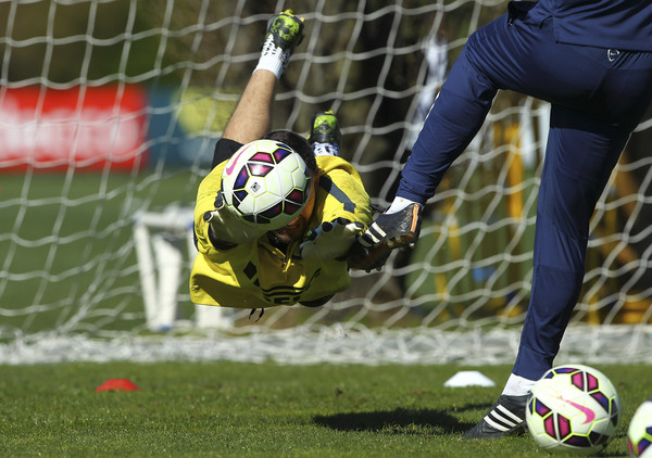 Samir Handanovic of FC Internazionale Milano dives to save a shot during an FC Internazionale training session at the club's training ground on April 7, 2015 in Appiano Gentile Como, Italy.