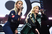 Rita Ora and Iggy Azalea perform onstage during HOT 99.5's Jingle Ball 2014, Presented by Mattress Warehouse at the Verizon Center on December 15, 2014 in Washington, D.C.