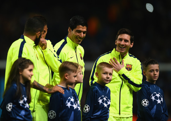 Lionel Messi Luis Suarez and Lionel Messi of Barcelona share a joke as the teams line up during the UEFA Champions League Round of 16 match between Manchester City and Barcelona at Etihad Stadium on February 24, 2015 in Manchester, United Kingdom.