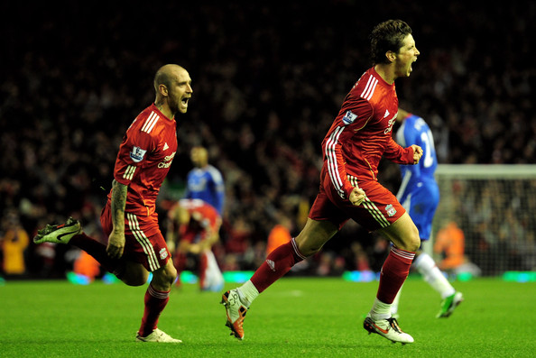 Fernando Torres (R) of Liverpool celebrates scoring his team's second goal with team mate Raul Meireles during the Barclays Premier League match between Liverpool and Chelsea at Anfield on November 7, 2010 in Liverpool, England.