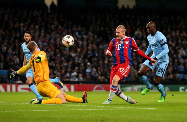 Sebastian Rode of Bayern Muenchen has his shot on goal saved by Joe Hart of Manchester City during the UEFA Champions League Group E match between Manchester City and FC Bayern Muenchen at the Etihad Stadium on November 25, 2014 in Manchester, United Kingdom.