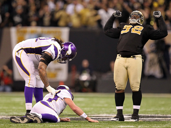 Phil Loadholt Phil Loadholt #71 of the Minnesota Vikings checks on teammate Brett Favre #4  after he was hit by Remi Ayodele #92 of the New Orleans Saints during the NFC Championship Game at the Louisiana Superdome on January 24, 2010 in New Orleans, Louisiana.