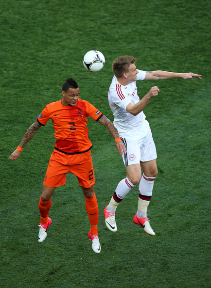 Gregory van der Wiel of Netherlands and  Nicklas Bendtner of Denmark compete for the ball during the UEFA EURO 2012 group B match between Netherlands and Denmark at Metalist Stadium on June 9, 2012 in Kharkov, Ukraine.
