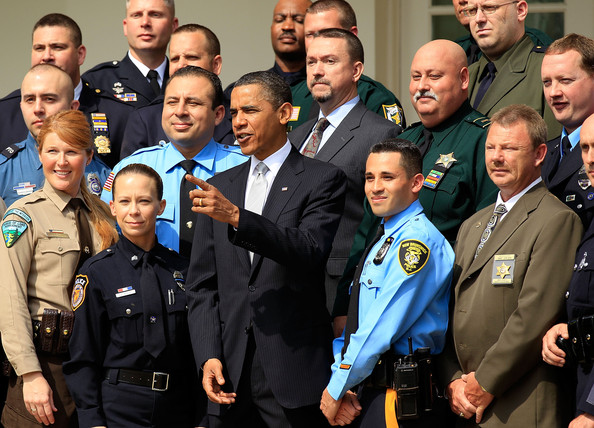 U.S. President Barack Obama (C) poses for photographers with winners of the 2010 National Association of Police Organizations (NAPO) TOP COPS award during a Rose Garden event May 14, 2010 at the White House in Washington, DC. The awards were to pay tribute to outstanding law enforcement officers across the country for actions above and beyond the call of duty.