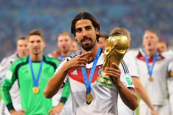 Sami Khedira of Germany celebrates with the World Cup trophy after defeating Argentina 1-0 in extra time during the 2014 FIFA World Cup Brazil Final match between Germany and Argentina at Maracana on July 13, 2014 in Rio de Janeiro, Brazil.