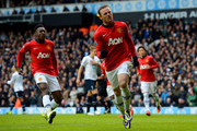 Wayne Rooney of Manchester United celebrates scoring their second goal from the penalty spot during the Barclays Premier League Match between Tottenham Hotspur and Manchester United at White Hart Lane on December 1, 2013 in London, England.