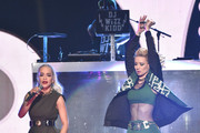 Rita Ora (L) and  Iggy Azalea perform onstage during iHeartRadio Jingle Ball 2014, hosted by Z100 New York and presented by Goldfish Puffs at Madison Square Garden on December 12, 2014 in New York City.