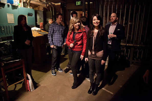 Miranda Cosgrove (R) and Jenette McCurdy wait backstage before meeting the children of military personnel at Naval Submarine Base New London on January 11, 2012 in Groton, Connecticut. The cast of iCarly were presenting a special military family screening of iMeet The First Lady, an episode of their show featuring Michelle Obama.